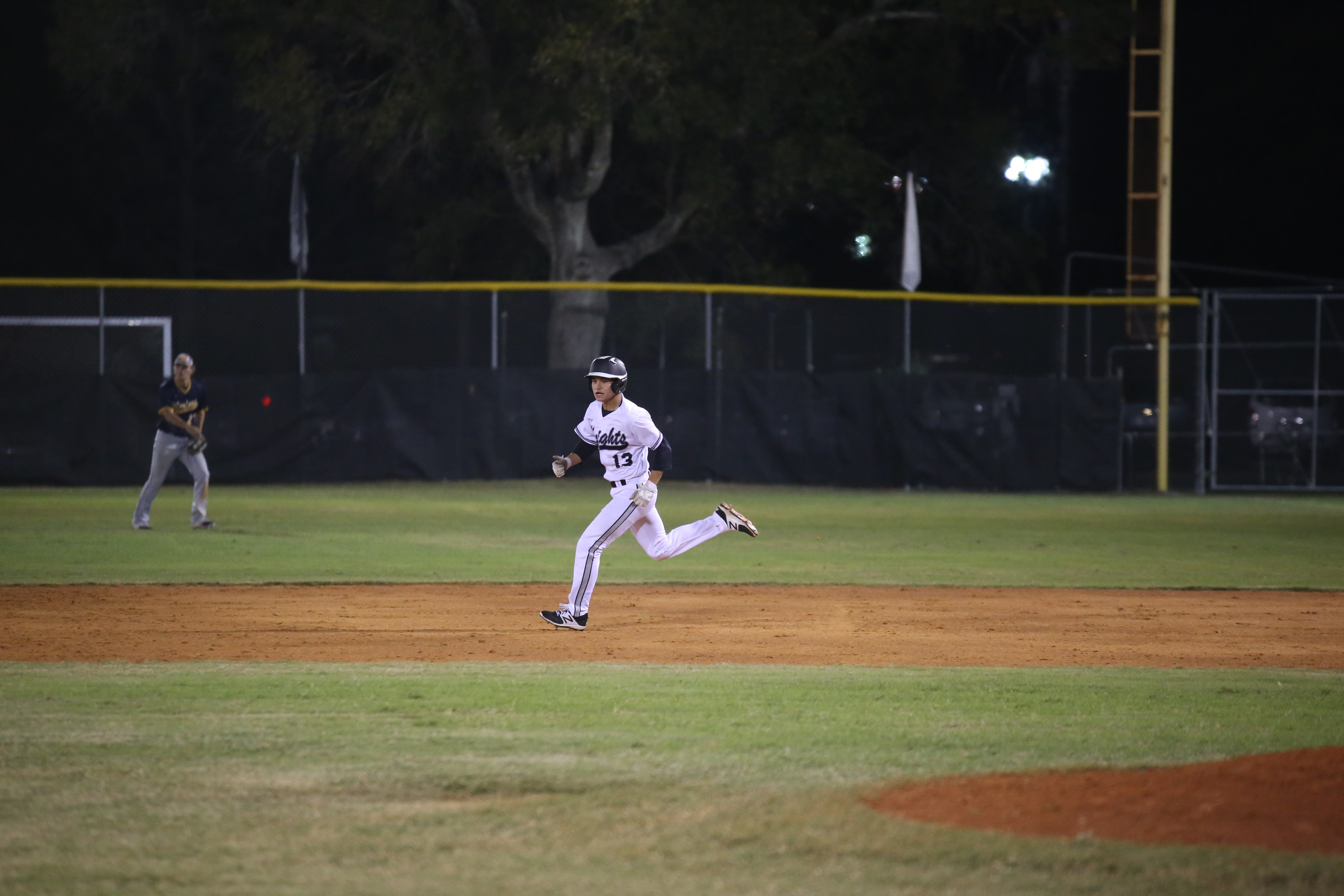 Outfielder Aaron Scott ('17) runs to second during the Knights' 6-5 loss to Steinbrenner.