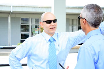 Mr. Johan von Ancken takes a moment to talk with Mr. Gary Brady after school in the courtyard.