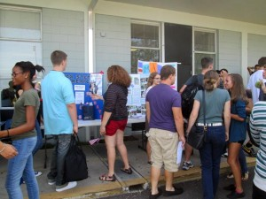 Students gather outside the cafeteria during lunch to see what clubs are available to join for the 2012-2013 school year.