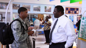 Principal Johnny Bush talks to a member of the military at a back-to-school event on MacDill Air Force Base.