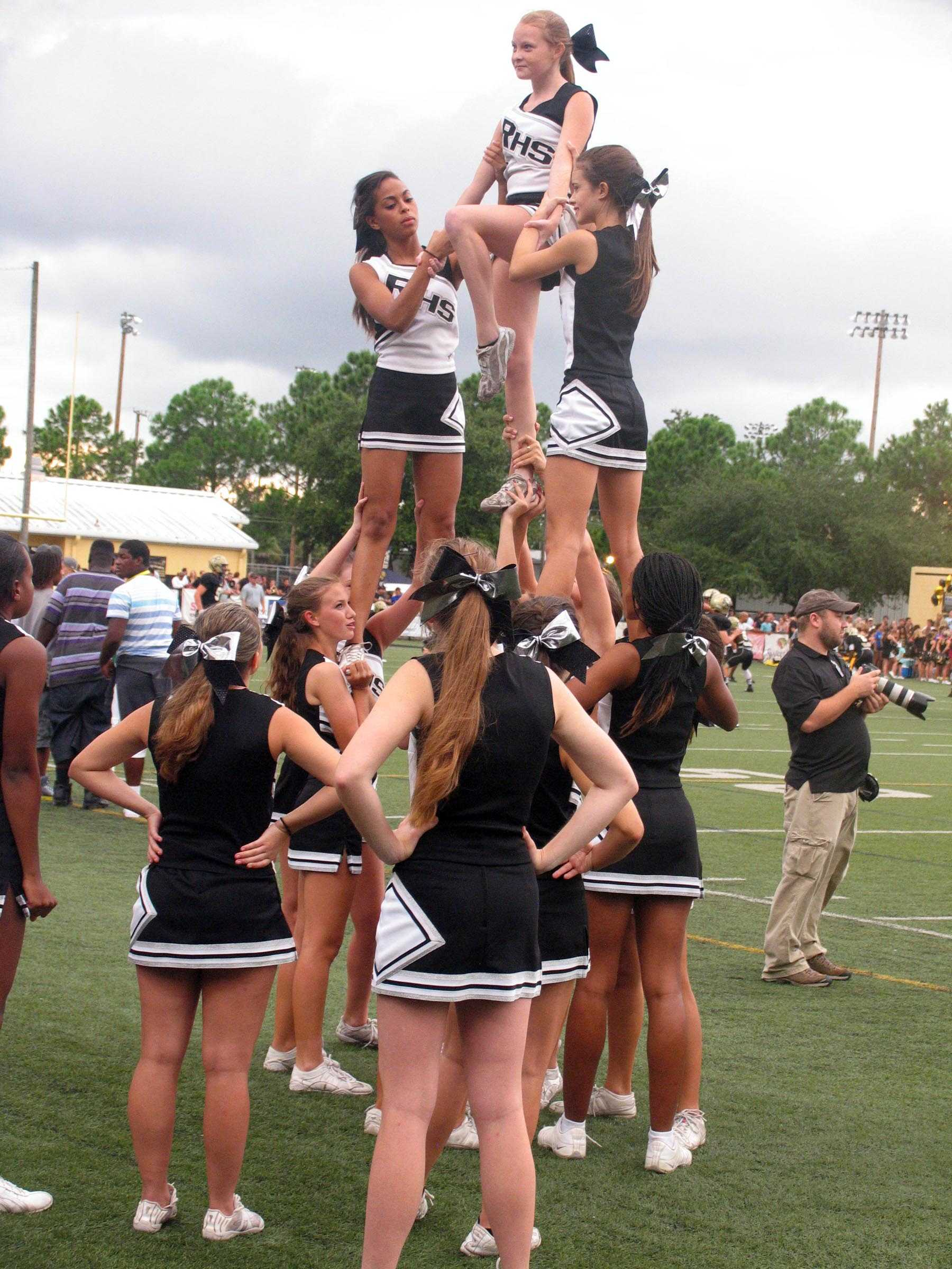 Rhs+cheerleaders+showing+pep+by+doing+stunts.+The+varsity+cheerleaders+are+a+made+up+of+seniors%2C+juniors+and+even+sophmores.
