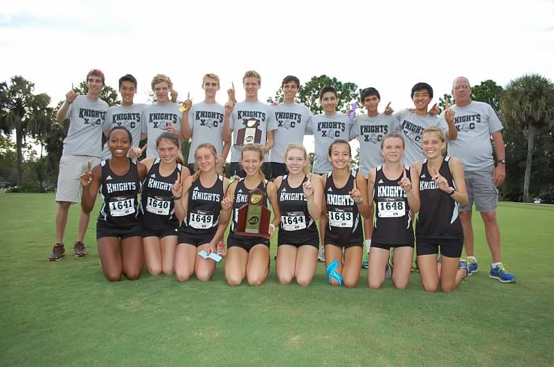 The boys and girls cross country team pose for a picture after their wins Wednesday afternoon. The teams are lead by head Coach Mark Altimari and assistant coach Melissa Mosseau.