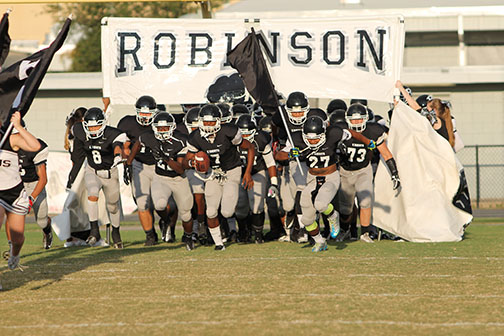 The football team charges out at the Jefferson game