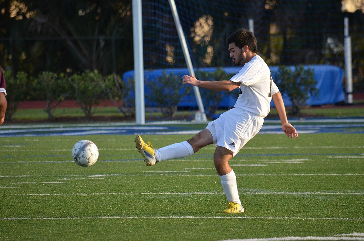 Senior, Gabriel Gonzalez clearing the ball from a possible goal by the Middleton Tigers.