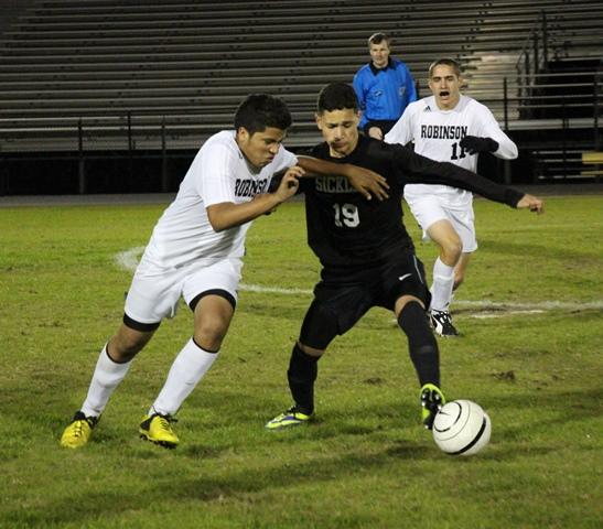 Senior Daviel Xiques driving past a Sickles defender.