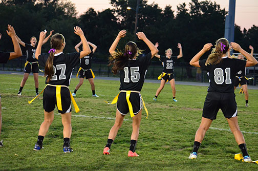 The team warming up at the state championships in 2014.