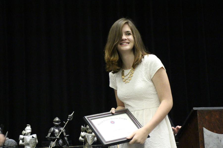 Senior Lauren Wheatley receives an award for her athletic accomplishments as a member of the volleyball team.