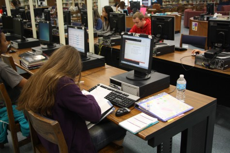 Sydney Clark ('15) makes use of the computers in the media center by working on her math homework.