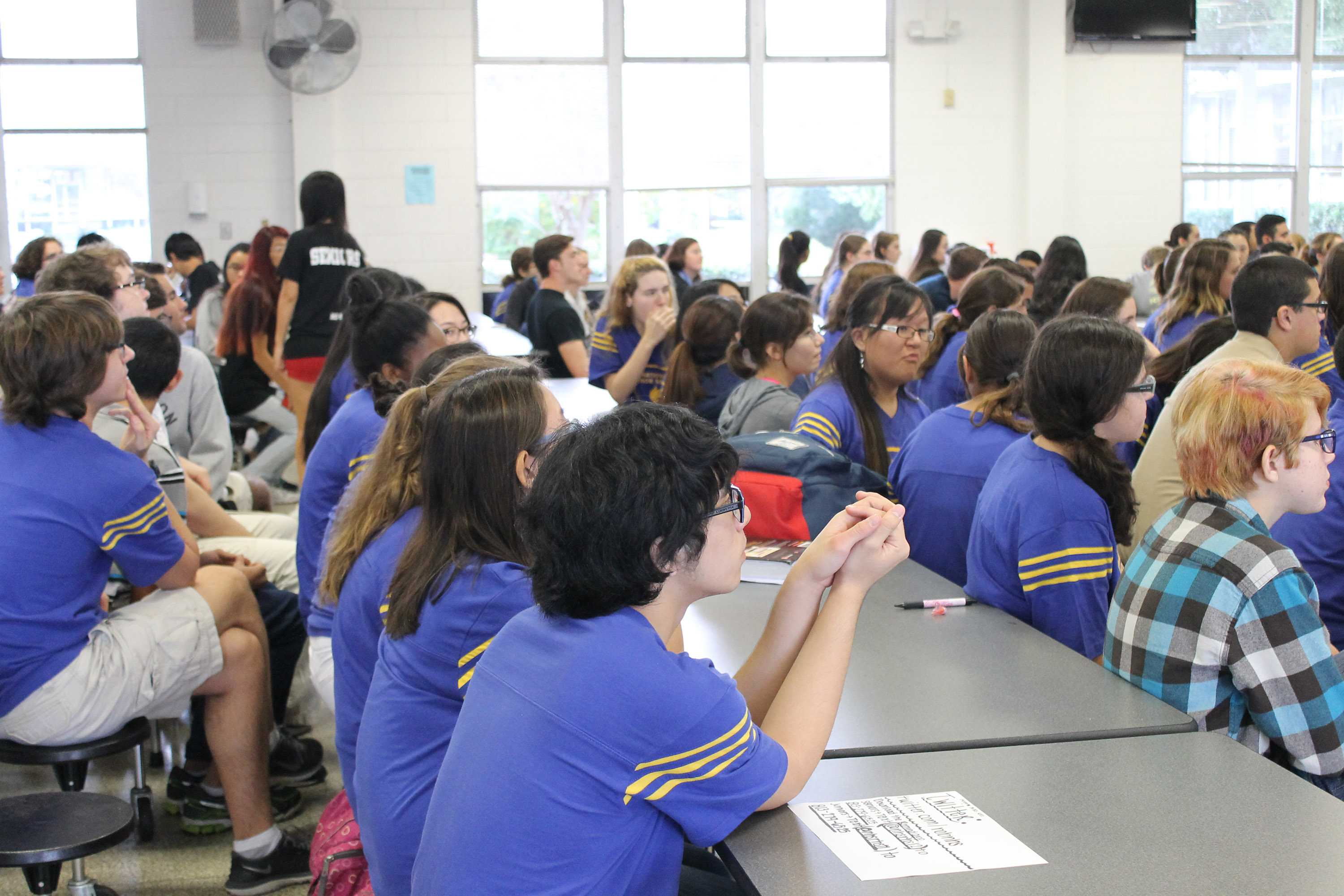 National Honor Society members attend a meeting in the cafeteria.