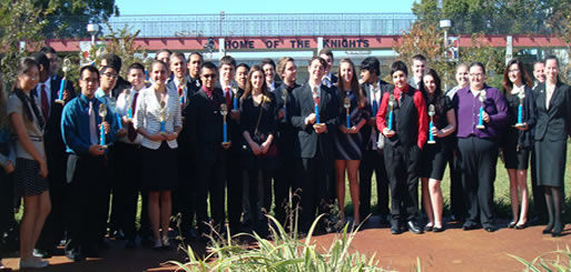 FBLA members pose with awards after attending the awards ceremony.