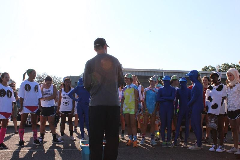 Head Coach Josh Saunders explains the rules of the race to the team.