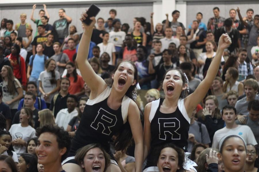 Cheerleaders Katherine Weck and Lauren Cohen participate in the spirit chant during the 2015 Plant pep rally.