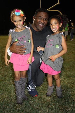 Ellie, Robinson principal Johnny Bush and younger sister Jayda pose for a photo before the lighting of the RHS letters.