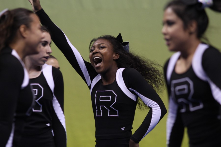 Aaliyah Cole ('16) waves to the crowd at the state semifinals.