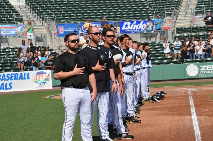 The Knights remove their caps for the Pledge of Allegiance during the state semifinal game in 2015 held at jetBlue park.