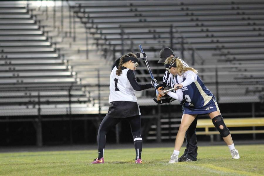 Captain Alexa Keeler ('17) in a face-off during Friday night's win against Alonso.