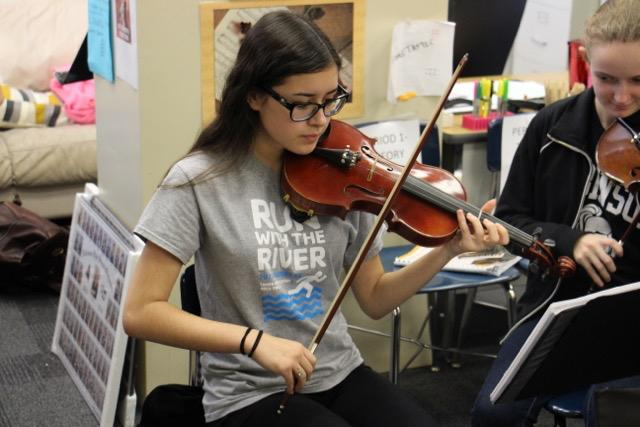 Erin Walker ('18) plays her violin while in class.