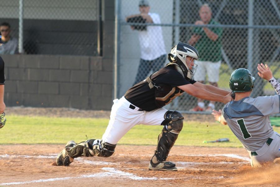 Catcher Shawn McGory ('16) tags out Sickles' Johnathan Oddson ('16).