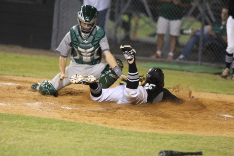 Shortstop Killian McCray ('17) slides into home plate for the Knight's XTH run of the night.