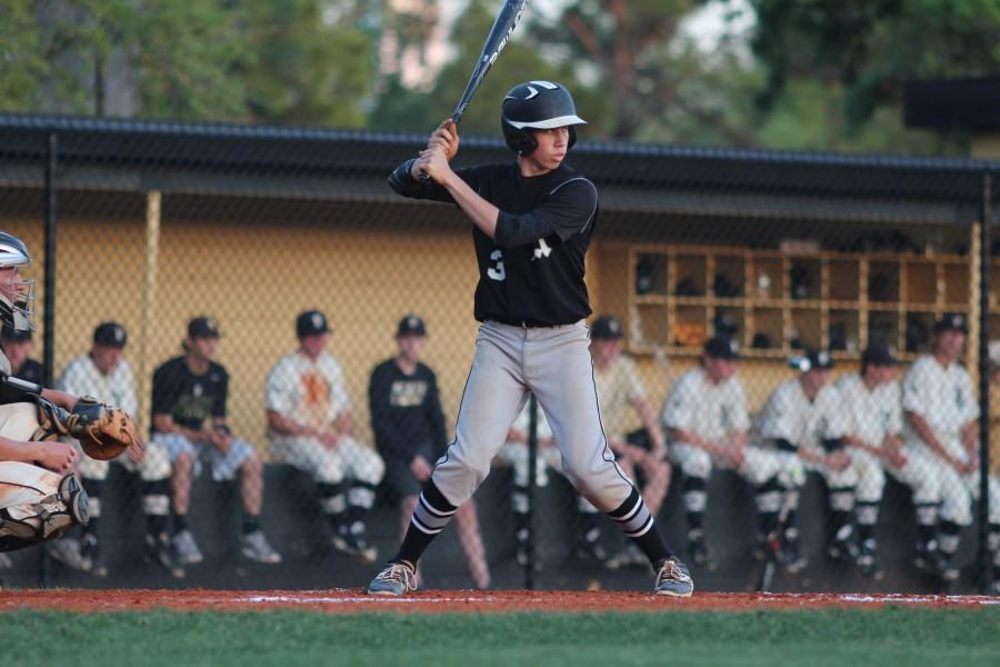 In the top of the first inning, Matthew Steckel ('16) readies to bat. Steckel's RBI double in the top of the seventh drove in the Knights' fifth run of the night.