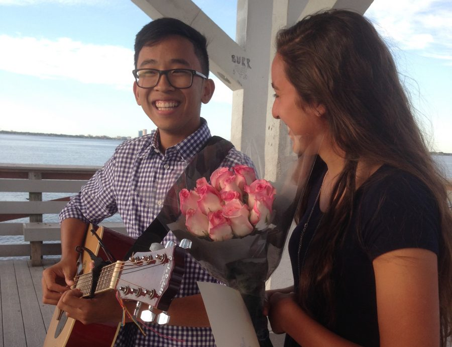 With flowers in hand, Natalia Ayoub ('17) smiles at boyfriend Sean Tran ('17) after he asked her to prom at the Ballast Point Pier.
