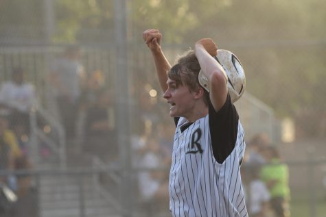 After scoring the Knights' first run, which tied the game, Mitchell Tozian ('16) takes off his helmet in celebration.