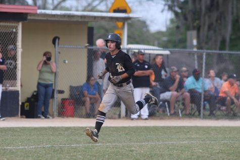 Off a sacrifice fly by Matthew Steckel ('16), Killian McCray runs into home for the Knights' first run of the night.