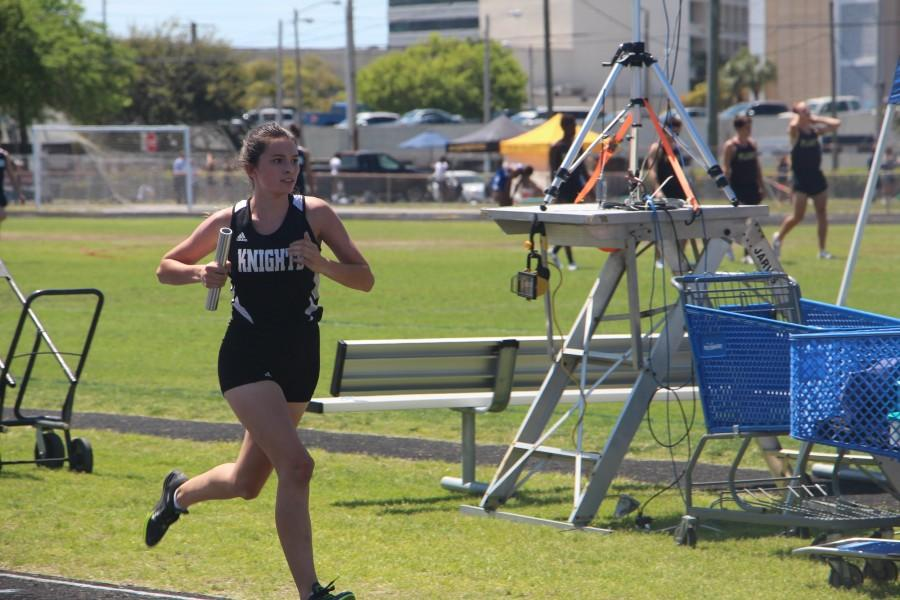 Going+into+her+second+lap%2C+Raegan+Giberson+%28%2717%29+runs+the+third+leg+of+the+4x800m+relay+at+Jefferson+High+School.+Giberson+ran+the+4x800m+relay+and+the+3200m+run+for+the+Knights.