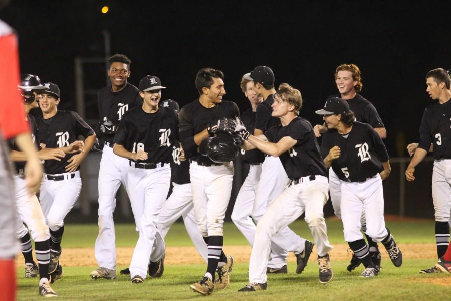 The team celebrates after Joey Scionti ('17) delivered a game-winning sacrifice fly to score  Aaron Scott ('17).