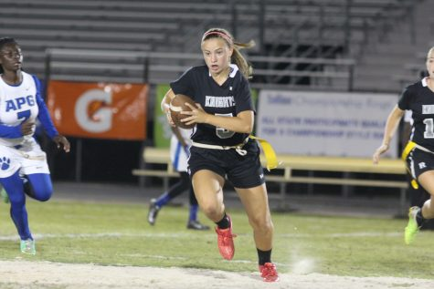 Linebacker Kelly Dorsey ('16) runs with the ball after making an interception with less than a minute remaining in the fourth quarter.
