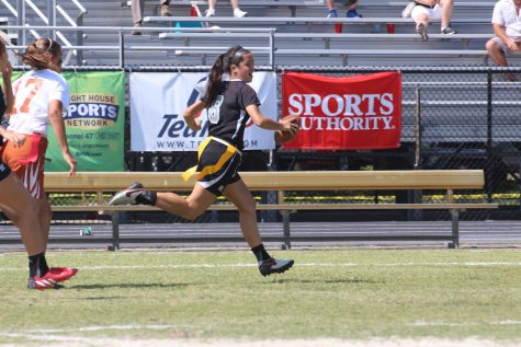 After an interception, Tess Brookes ('16) runs away towards the Knights' end zone during the third quarter.
