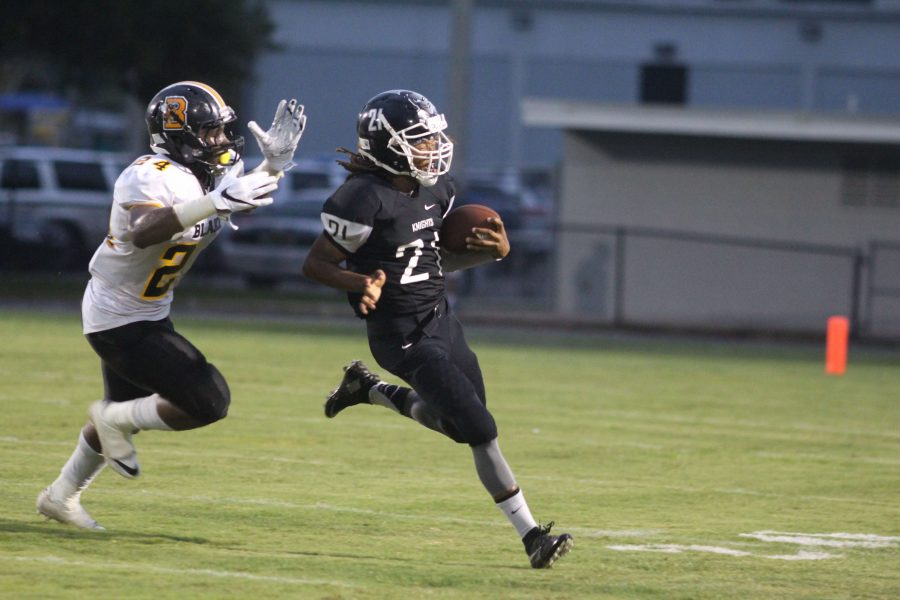Robinson quarterback Najee Fitzgerald ('17) attempts to run the ball while Blake's Jaiden Morris ('17) reaches out for the sack. Sacks were problematic for the Knights, who were sacked 12 times in the 22-8 loss.