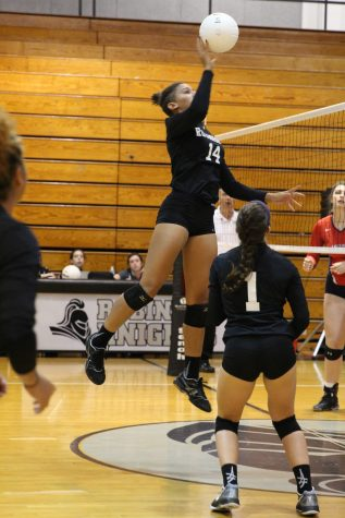 Captain McKenna Tyson ('17) taps the ball over the net after a set by #1 Ashley Osiason ('18).