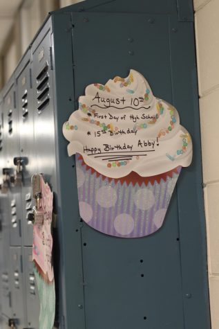 Patterson's parents put up the cupcake posters on either side of her locker.