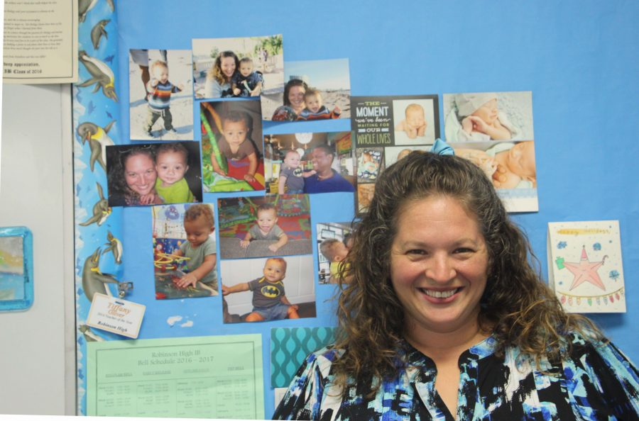 Biology+teacher+stands+near+a+board+with+photos+of+her+son%2C+Mason.