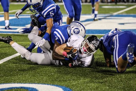 Tigers, Davis prove district dominance in 56-3 win over the Knights