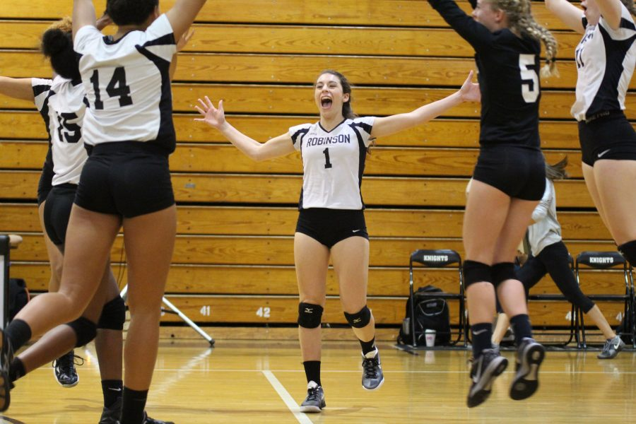 Setter+Ashley+Osiason+%28%2718%29+celebrates+after+the+Knights+scored+the+winning+point+to+end+the+third+set+and+the+game.