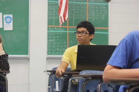 Ralph Gonzalez ('17) listens intently to the discourse.