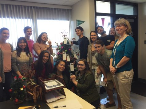 Leah-Fernandez's leadership class poses with the giving tree.