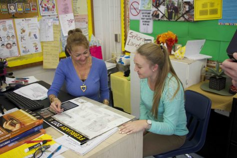 Here Señora Landron practices being patient while talking with a student about her Spanish External Assessment.
