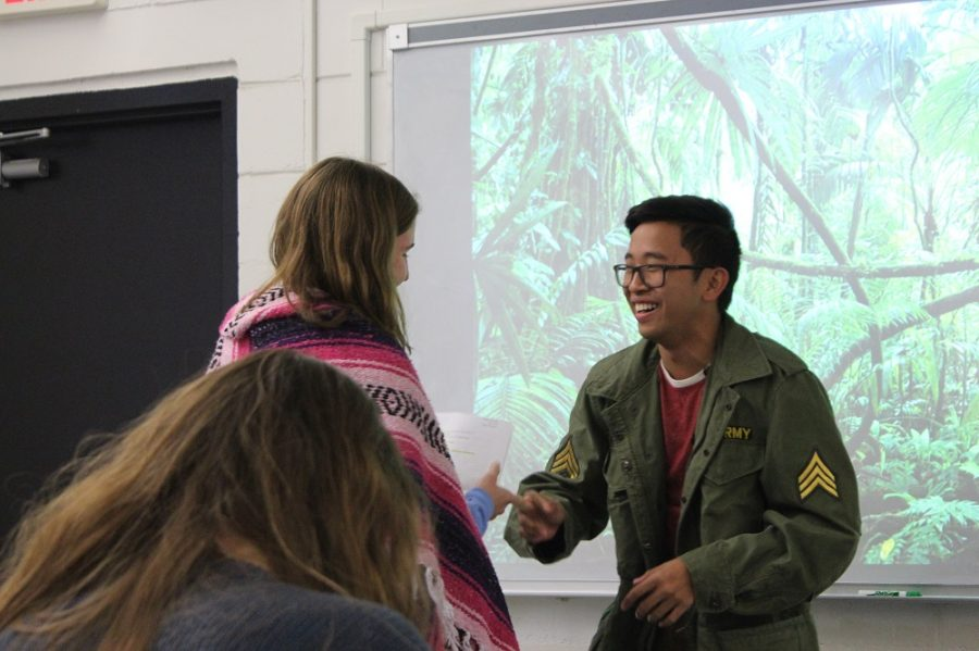 Sean Tran ('17, right) and Alexis Petterson ('17, left) perform a skit about the Guatemalan Revolution.