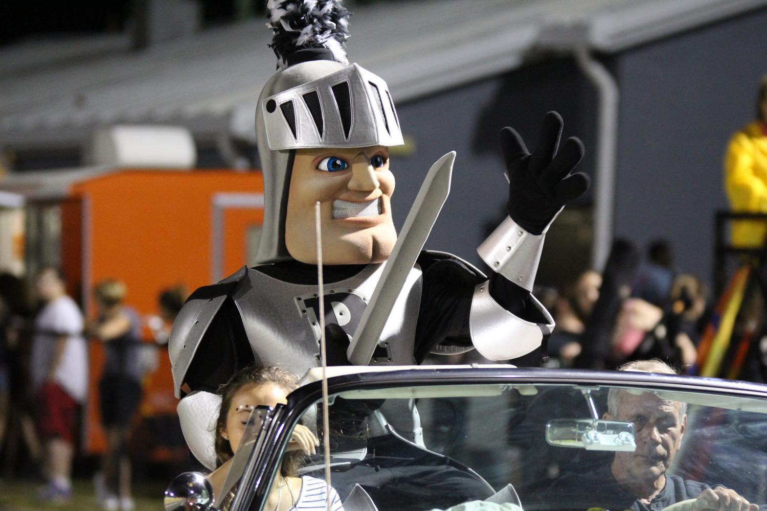 The Knight mascot rides in a convertible during the court presentation at the 2016 homecoming game. After the school district decides to cancel school, due to hurricane threat, administration reschedules homecoming festivities.
