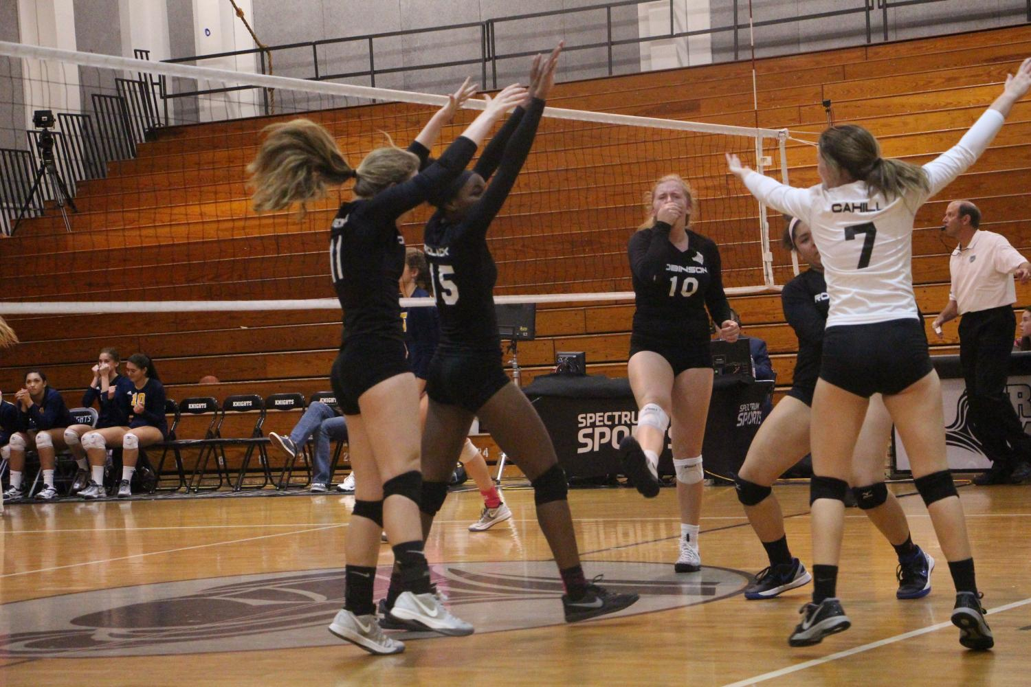 Lady Knights celebrate as the score a point against Steinbrenner on Monday night.