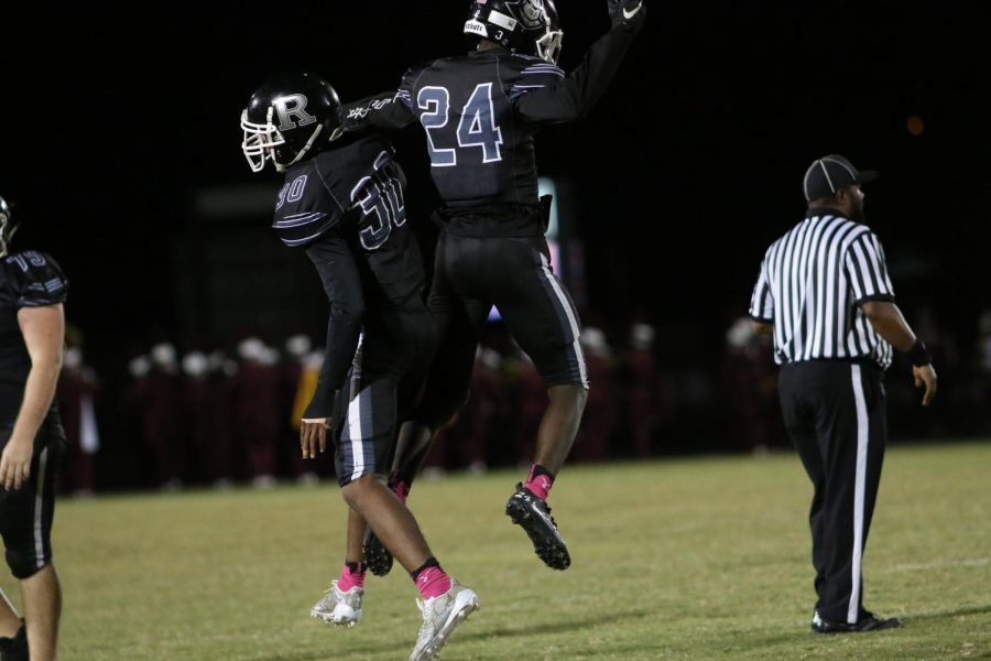 Tevin Fordham ('18) and Christopher Rolack ('18) chest bump after an interception for the Knights.