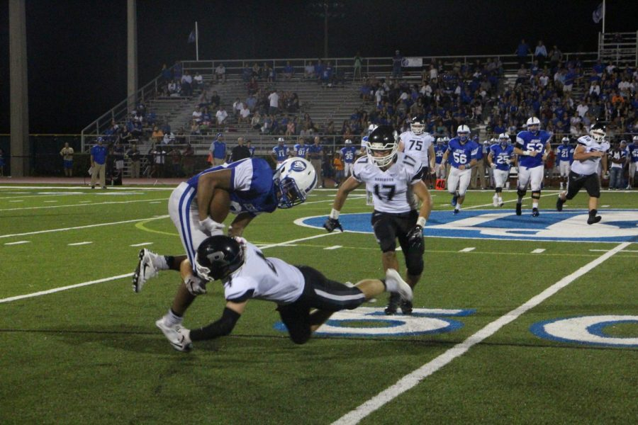 Eann Johnson ('18) makes the tackle against Jesuit on Friday night.