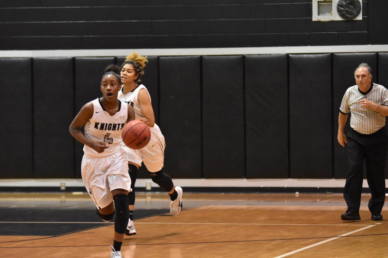 Kaliah Henderson ('18) leads her team up the court during an intense 2016-2017 season game.