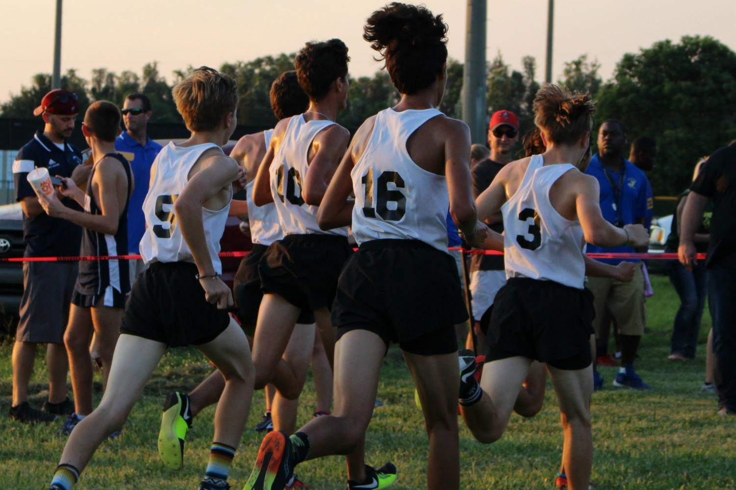 The 2017 boys cross country team races to the finish line.