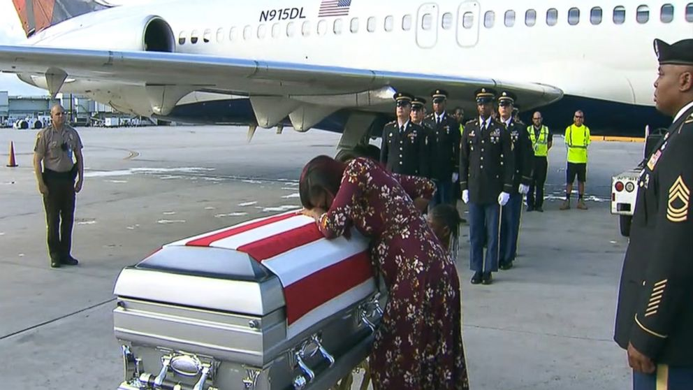 La David Johnson's widow crying over his casket.