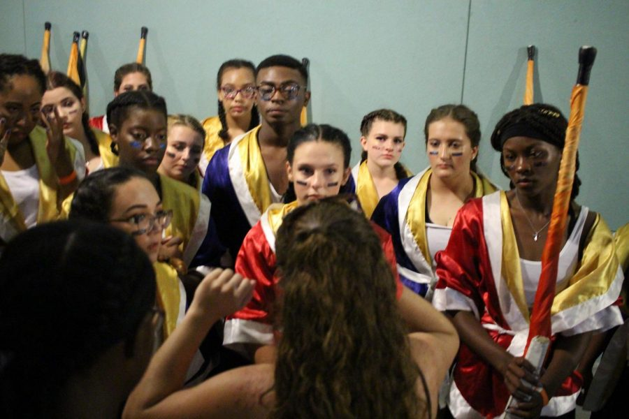 The Starlets receive feedback from Starlets Director Siara Espejo after performing in the courtyard of Newsome High School. The Newsome competition was moved indoors due to the weather and the band could not march their complete show,