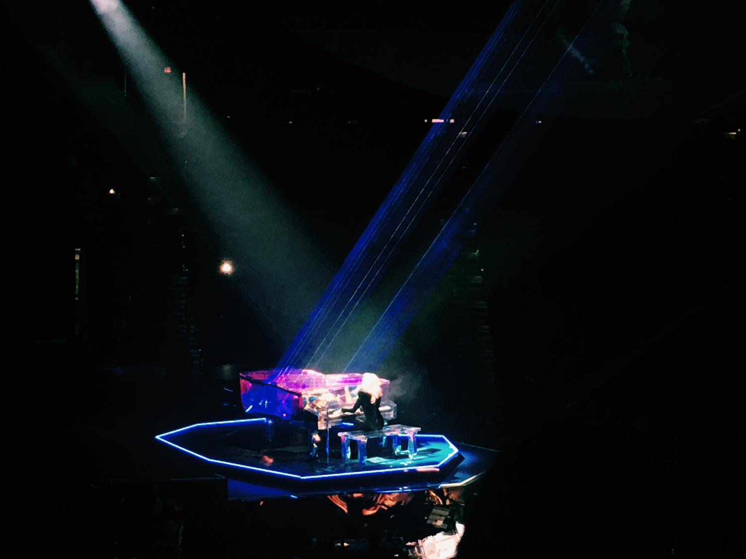 GaGa plays the piano during the concert
